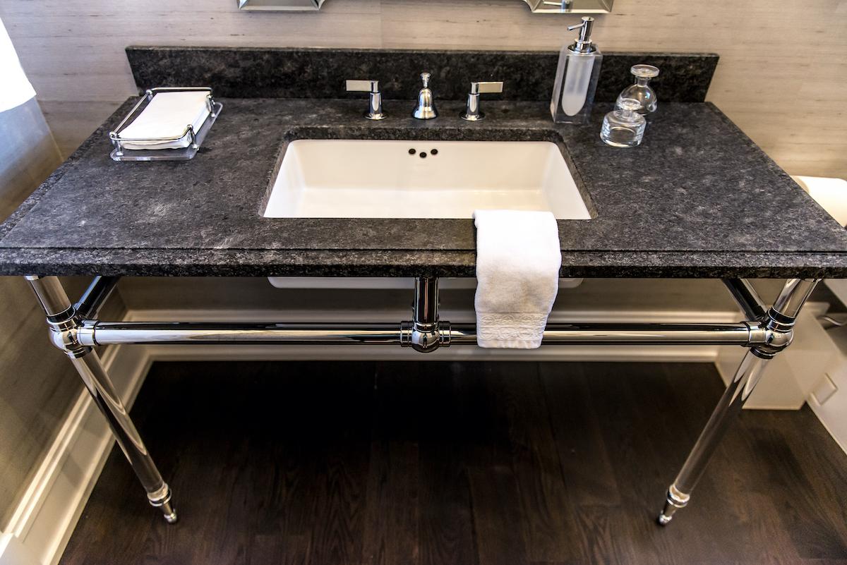 bathroom-black-stone-countertop-silver-table-legs