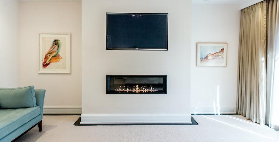 bedroom-fireplace-under-flat-screen-tv
