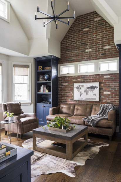 brick-wall-living-room-leather-couches-faux-fur-rug