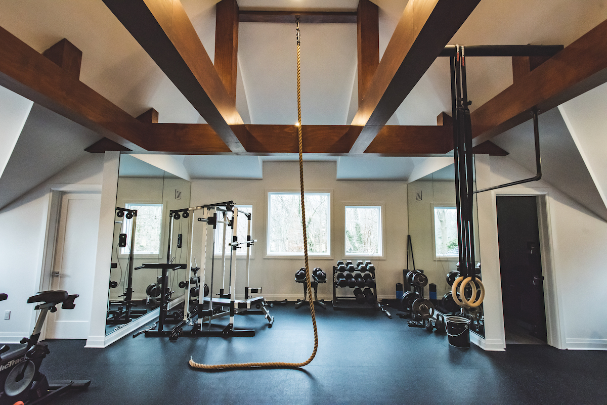 home-gym-sands-point-ny-interior-design-wooden-beam-ceiling