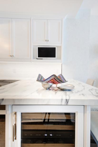 marble-countertop-wine-fridge-white-cabinets
