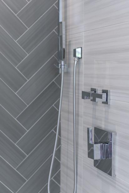 shower-details-stainless-steel-chevron-tile