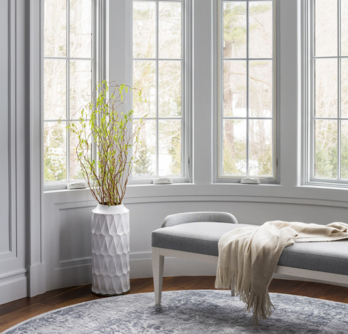 bench-with-throw-blanket-vase-flowers
