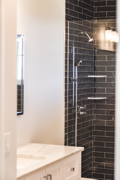 black-subway-tile-shower-design