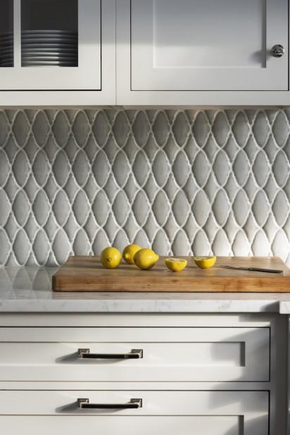 cutting-board-lemons-marble-countertop-backsplash-design