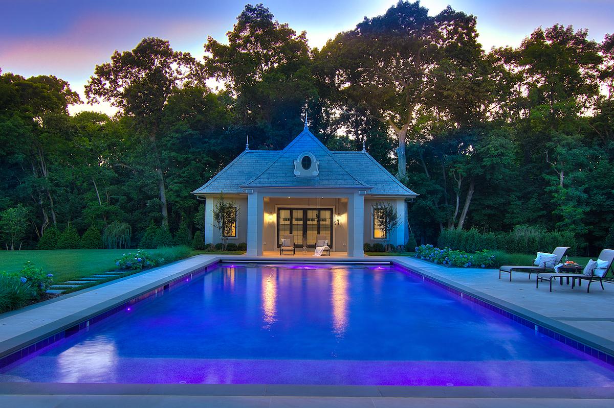 inground-pool-purple-blue-lights-pool-house