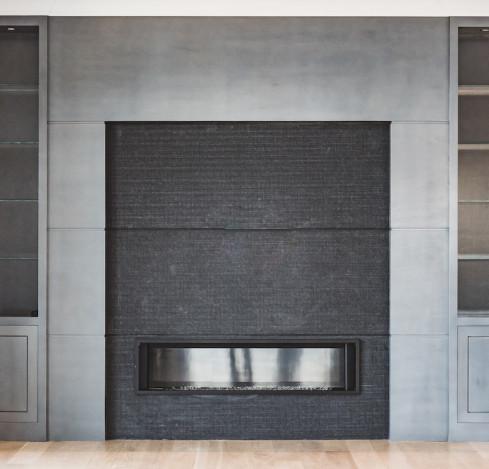 large-fireplace-gray-black-modern-built-in-shelves