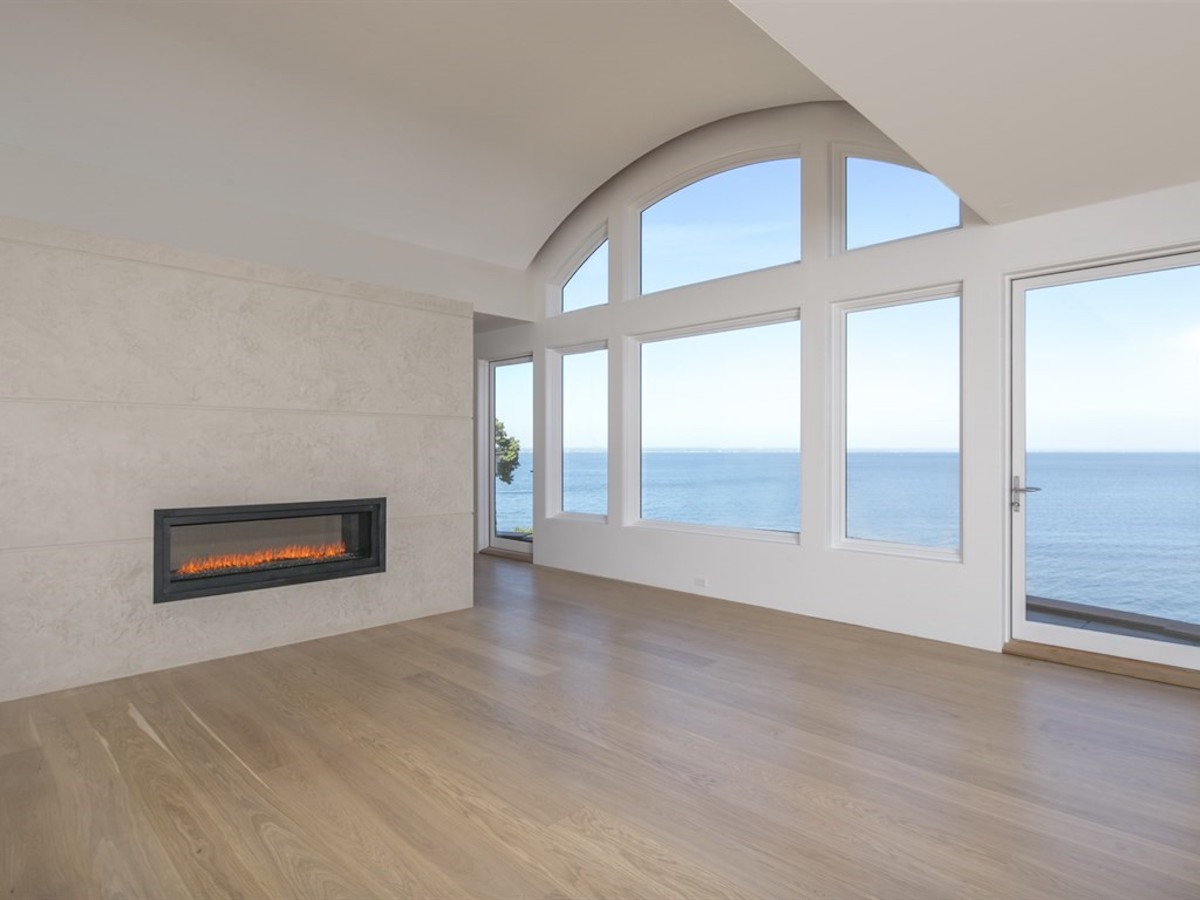 master-bedroom-fireplace-picture-windows-sands-point-ny